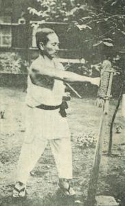 Gichin Funakoshi punching the makiwara
